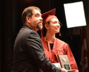 Dr. Isaacs presenting Elyse Peter with the 2016 Aldente Dentistry Award for Music Excellence at the Waterdown District High School commencement